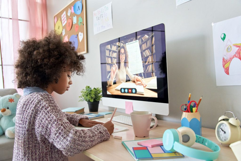 African school kid girl distance learning by video conference call chat with remote teacher